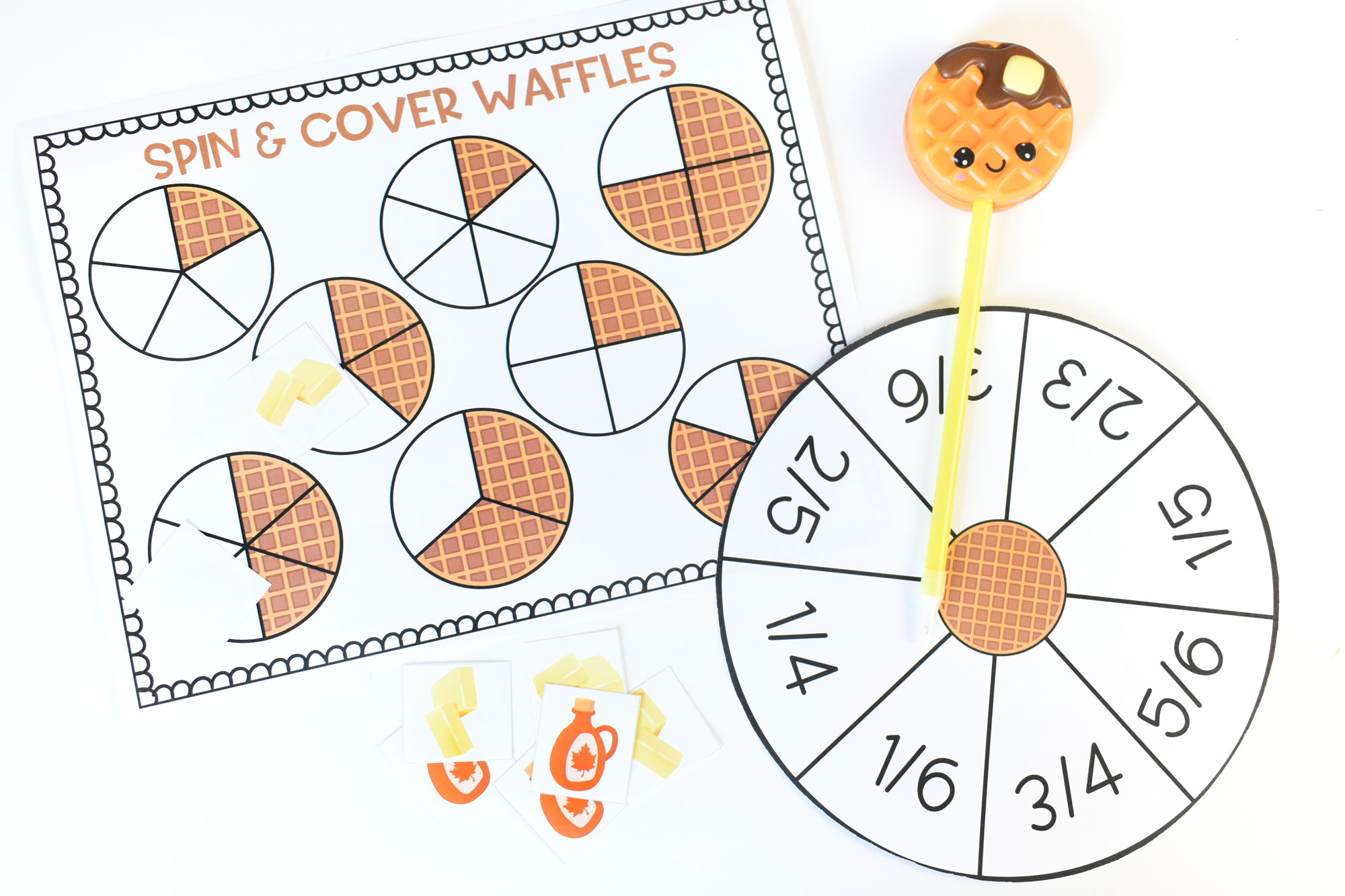 Spin and Cover Waffle Fractions | HolidayPrintables.net #fractions #math #printables #mathprintable #waffleday #homeschool #homeschoolprintables #homeschoolmoms #educationprintables #weloveprintables #holidayprintables