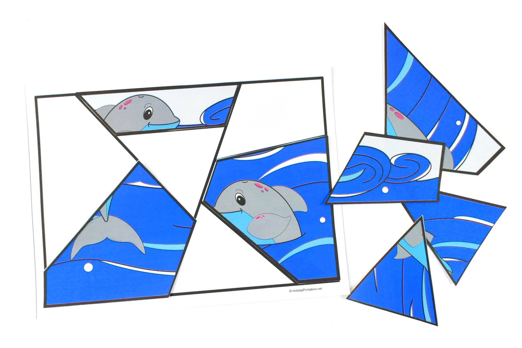 Free Printable Dolphin Puzzle | HolidayPrintables.net #printables #dolphins #educationprintables #homeschoolprintables #preschoolprintables #freeprintables #weloveprintables #holidayprintables
